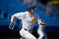 Michigan Wolverines shortstop Jack Blomgren (18) runs to first base after laying down a bunt during a game against Army West Point on February 18, 2018 at Tradition Field in St. Lucie, Florida.  Michigan defeated Army 7-3.  (Mike Janes/Four Seam Images)