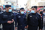Palestinian policmen officers patrol at a market during Muslim holy month of Ramadan, in Khan Younis in the southern Gaza Strip on April 22, 2021 amid the coronavirus disease (COVID-19) outbreak. Palestinians welcomed the Muslim fasting month of Ramadan under the shadow of economic difficulties caused by the Israeli blockade and the coronavirus pandemic. Nineteen people have died of the coronavirus disease in Palestine in the last 24 hours and 1652 new cases were recorded, according to the daily report on the disease. Health Minister Mai Alkaila said 11 of the dead and 1179 of the new cases were in the Gaza Strip. Photo by Ashraf Amra
