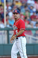 Head coach Mike Bianco #5 of the Ole Miss Rebels looks on during Game 4 of the 2014 Men's College World Series between the Virginia Cavaliers and Ole Miss Rebels at TD Ameritrade Park on June 15, 2014 in Omaha, Nebraska. (Brace Hemmelgarn/Four Seam Images)
