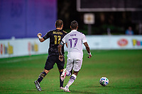 LAKE BUENA VISTA, FL - JULY 20: Alejandro Bedoya #11 of the Philadelphia Union and Nani #17 of Orlando City SC battle for the ball during a game between Orlando City SC and Philadelphia Union at Wide World of Sports on July 20, 2020 in Lake Buena Vista, Florida.
