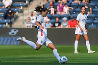 BRIDGEVIEW, IL - JULY 18: Dzsenifer Marozsan #8 of the OL Reign kicks the ball during a game between OL Reign and Chicago Red Stars at SeatGeek Stadium on July 18, 2021 in Bridgeview, Illinois.