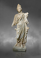 Roman statue of Tyche. Marble. Perge. 2nd century AD. Inv no . Antalya Archaeology Museum; Turkey.  Against a grey background<br /> <br /> Tyche was the presiding tutelary deity who governed the fortune and prosperity of a city, its destiny. In Classical Greek mythology, she is the daughter of Aphrodite and Zeus or Hermes.