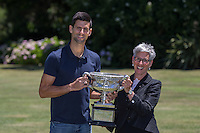 February 1, 2016: Novak Djokovic of Serbia and Her Excellency the Honourable Linda Dessau AM<br /> Governor of Victoria hold the Norman Brookes Challenge Cup during the Men's Champion Photocall  at Government House, Melbourne, Australia. Photo Sydney Low