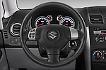 Car pictures of steering wheel view of a 2013 Suzuki SX4 Grand Luxe Exterior 5 Door SUV 2WD Steering Wheel
