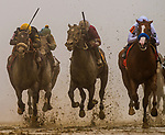 BALTIMORE, MD - MAY 19: Justify #7 with Mike Smith hold off the late charge of Bravazo #8 with Luis Saez and Tenforld #6 with Ricardo Santana Jr. to win the 143rd Preakness Stakes at Pimlico Racecourse on May 19, 2018 in Baltimore, Maryland. (Photo by Alex Evers/Eclipse Sportswire/Getty Images)