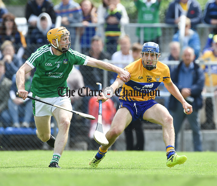 Ritchie English of Limerick in action against Shane O Donnell of Clare during their Munster championship game in Ennis. Photograph by John Kelly.