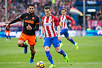 Kevin Gameiro of Atletico de Madrid competes for the ball with Aderlan Santos of Valencia CF  during the match of Spanish La Liga between Atletico de Madrid and Valencia CF at  Vicente Calderon Stadium in Madrid, Spain. March 05, 2017. (ALTERPHOTOS / Rodrigo Jimenez)