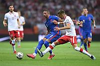 8th September 2021; PGE National Stadium, Warsaw, Poland: FIFA World Cup 2022 Football qualification, Poland versus England;  Kyle Walker passes across Jan Bednarek