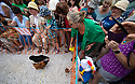 04/08/19<br /> <br /> Owners egg-on their hens to step over the line first by shaking food tins and calling their names.<br /> <br /> Hundreds of spectators watch as competitors race their hens at the World Championship Hen Racing on a purpose-built track outside the Barley Mow pub in Bonsall, in the Derbyshire Peak District.<br />  <br /> All Rights Reserved, F Stop Press Ltd +44 (0)7765 242650 www.fstoppress.com rod@fstoppress.com