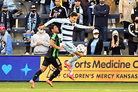 KANSAS CITY, KS - MAY 9: Daniel Salloi #20 Sporting KC controls the ball in the air during a game between Austin FC and Sporting Kansas City at Children's Mercy Park on May 9, 2021 in Kansas City, Kansas.