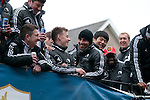 Leon Britton as Swansea City Football team celebrating during an open-top bus parade through the centre of Swansea after beating Bradford City 5-0 in Sunday's Capital One Cup final at Wembley to win the Capital Cup trophy.