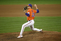 Pitcher Carson Spiers (23) of the Clemson Tigers delivers a pitch against the Stony Brook Seawolves on Friday, February 21, 2020, at Doug Kingsmore Stadium in Clemson, South Carolina. Clemson won, 2-0. (Tom Priddy/Four Seam Images)