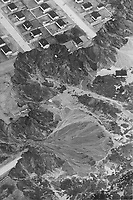 Saint-Jean-Vianney - Le gouffre<br /> , le 4 mai 1971<br /> <br /> Neat frame houses cling to the edge of 100-feet-deep crater gouged in St. Jean Vianney; Que.; by a landslide that swept away three streets of houses and left them looking like discarded dollhouses from the air. Cars also were carried down into the churning morass; and the road to the village of 1;300 was buried under tons of mud (lower left). Some residents whose houses still stand dangerously near the still advancing rim say they'll never return to them.<br /> <br /> PHOTO :  Jeff Goode - Toronto Star Archives - AQP