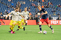 FOXBOROUGH, MA - MAY 16: Adam Buksa #9 of New England Revolution approaches the Columbus SC goal during a game between Columbus SC and New England Revolution at Gillette Stadium on May 16, 2021 in Foxborough, Massachusetts.