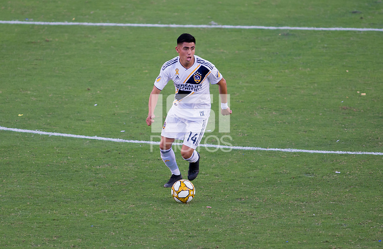 CARSON, CA - SEPTEMBER 29: Joe Corona #14 of the Los Angeles Galaxy moves with the ball during a game between Vancouver Whitecaps and Los Angeles Galaxy at Dignity Health Sports Park on September 29, 2019 in Carson, California.