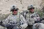 Spc. Bryce Esco, 25, of San Jose, Calif. (left) and Sgt. James Leatherwood, 25, of Dublin, Texas (right) relax while ordnance disposal experts defuse two booby-trapped bombs the two soldiers found in the village of Deh-e-Chowkay, in the Arghandab valley near Kandahar, Afghanistan. Had the bombs exploded, it would have likely killed or wounded their entire squad. May 26, 2010. DREW BROWN/STARS AND STRIPES