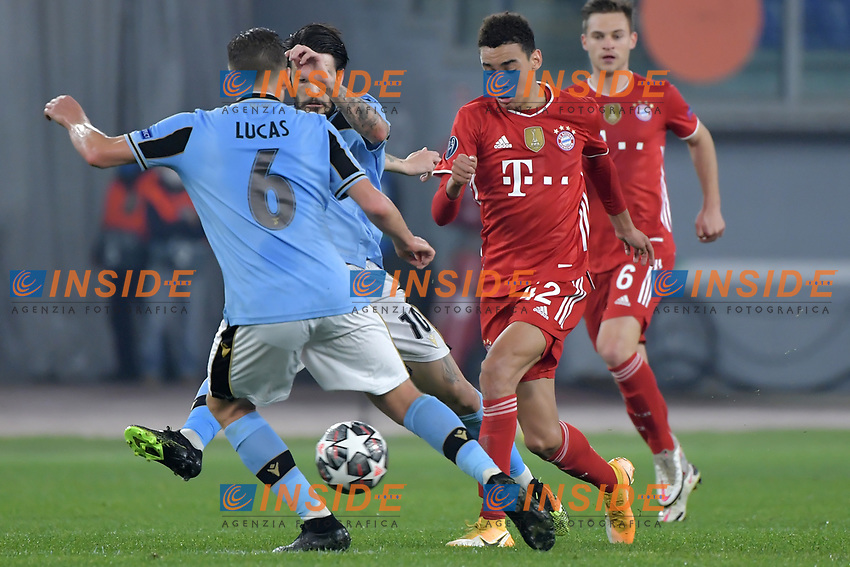 Jamal Musiala of FC Bayern Munchen vies for the ball with Luis Alberto and Lucas Leiva Pezzini of SS Lazio during the Champions League round of 16 football match between SS Lazio and Bayern Munchen at stadio Olimpico in Rome (Italy), February, 23th, 2021. Photo Andrea Staccioli / Insidefoto