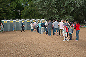 Visitors to the London 2012 Olympic Games Live Site in Hyde Park queue to use portable toilets.