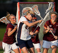 Marye Kellermann (29) of Virginia is checked from behind by Sam Voelker (17) of Virginia Tech during the first round of the ACC Women's Lacrosse Championship in College Park, MD.  Virginia defeated Virginia Tech, 18-6.