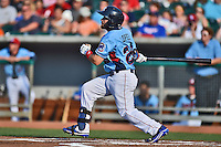Tennessee Smokies designated hitter Rafael Lopez #29 swings at a pitch during a game against the Birmingham Barons at Smokies Park on May 31, 2014 in Kodak, Tennessee. The Barons defeated the Smokies 2-1. (Tony Farlow/Four Seam Images)
