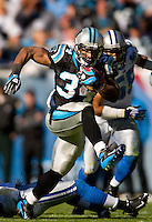 Carolina Panthers running back DeAngelo Williams (34) runs the ball against the Detroit Lions during an NFL football game at Bank of America Stadium in Charlotte, NC.