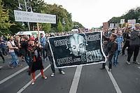 """In Berlin haben am Samstag den 30. August 2014 ca. 6.500 Menschen unter dem Motto """"Freiheit statt Angst"""" #fsa14 gegen massenhafte Ueberwachung demonstriert. Sie zogen mit einem Protestmarsch durch das Regierungsviertel und forderten u.a. die Abschaffung der Geheimdienste, vollstaendige Aufklaerung ueber die BND, NSA und andere Geheimdienstaktivitaeten und ein sofortiges Asyl fuer der Whistleblower Edward Snowden.<br /> Der Netzaktivist und Softwareentwickler Jacob Appelbaum, forderte die Mitarbeiter von Geheimdiensten dazu auf, Dokumente aus den Diensten der Oeffentlichkeit zur Verfuegung zu stellen. Auch riet er den anwesenden Menschen, bei den Geheimdiensten  Arbeit zu suchen und so an Unterlagen heran zu kommen.<br /> Im Bild: Mit Schild und rotem Hut: Anke Domscheit Berg von der Piraten-Partei.<br /> 30.8.2014, Berlin<br /> Copyright: Christian-Ditsch.de<br /> [Inhaltsveraendernde Manipulation des Fotos nur nach ausdruecklicher Genehmigung des Fotografen. Vereinbarungen ueber Abtretung von Persoenlichkeitsrechten/Model Release der abgebildeten Person/Personen liegen nicht vor. NO MODEL RELEASE! Don't publish without copyright Christian-Ditsch.de, Veroeffentlichung nur mit Fotografennennung, sowie gegen Honorar, MwSt. und Beleg. Konto: I N G - D i B a, IBAN DE58500105175400192269, BIC INGDDEFFXXX, Kontakt: post@christian-ditsch.de<br /> Urhebervermerk wird gemaess Paragraph 13 UHG verlangt.]"""