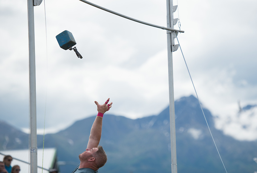 A competitor in the weight over height event during the 2015 Alaska Scottish Highland Games at the Palmer fairgrounds.