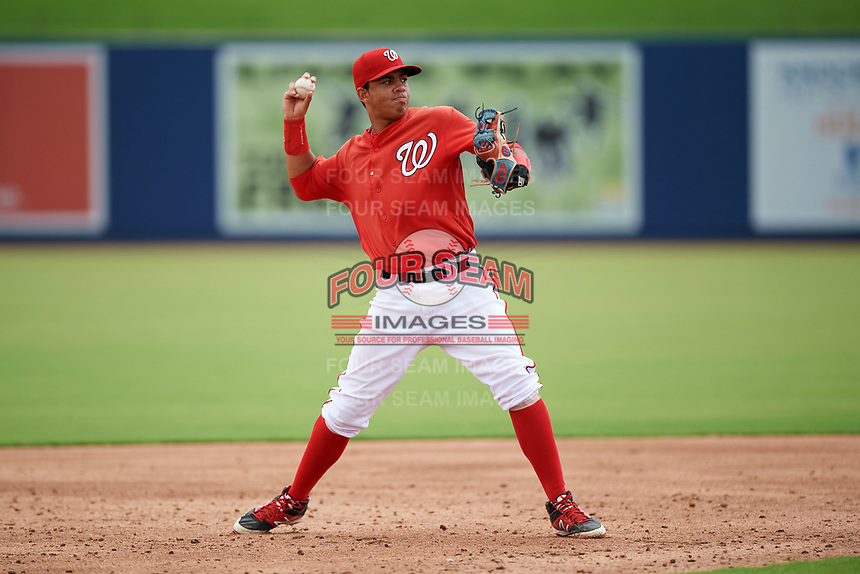 GCL Nationals second baseman Luis Garcia (7) warms up in between innings during the second game of a doubleheader against the GCL Mets on July 22, 2017 at The Ballpark of the Palm Beaches in Palm Beach, Florida.  GCL Mets defeated the GCL Nationals 4-1.  (Mike Janes/Four Seam Images)