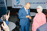Democratic presidential candidate and former Massachusetts governor Deval Patrick greets people and signs wooden eggs after speaking at Politics & Eggs at the New Hampshire Institute of Politics at Saint Anselm College in Manchester, New Hampshire, on Mon., November 25, 2019. Patrick is one of the latest entrants to the already crowded Democratic primary field, having only declared his candidacy the week before in mid-Nov. 2019.