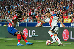 Alvaro Garcia Rivera (R) of Rayo Vallecano is tackled by Thomas Teye Partey of Atletico de Madrid during the La Liga 2018-19 match between Atletico de Madrid and Rayo Vallecano at Wanda Metropolitano on August 25 2018 in Madrid, Spain. Photo by Diego Souto / Power Sport Images