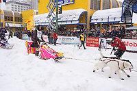 Saturday, March 3, 2012  Wade Marrs leaves the start line of the Ceremonial Start of Iditarod 2012 in Anchorage, Alaska.