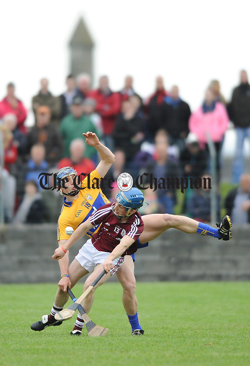 Clare's David Mc Inerney in action against Galway's Dara Dolan during  the challenge game as part of the Kilmurry Ibrickane GAA Club 100th anniversary celebrations. Photograph by John Kelly.