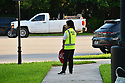 PEMBROKE PINES, FLORIDA - AUGUST 18: A school crossing guard is seen on the street for the first day of classes at Broward County school in Pembroke Pines, Florida, U.S., on Wednesday, Aug. 18, 2021.  Florida State Board of Education said it would force defiant school districts to comply with Republican Governor Ron DeSantis executive order forbidding them from mandating students wear masks as a way to slow a surge in Covid-19 cases.  ( Photo by Johnny Louis / jlnphotography.com )