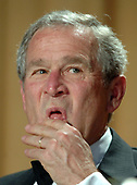 Washington, D.C. - April 29, 2006 -- United States President  George W. Bush attends the White House Correspondents' Association Dinner in Washington on April 29, 2006.  <br /> Credit: Roger L. Wollenberg - Pool via CNP