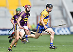 Tony Kelly of Clare in action against Paudie Foley of Wexford during their All-Ireland quarter final at Pairc Ui Chaoimh. Photograph by John Kelly.
