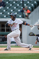 Jose Pirela (25) of the Scranton/Wilkes-Barre RailRiders follows through on his swing against the Charlotte Knights at BB&T BallPark on May 1, 2015 in Charlotte, North Carolina.  The RailRiders defeated the Knights 5-4.  (Brian Westerholt/Four Seam Images)