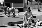 Notting Hill. North end of Portobello road, mother daughter market stall, selling old clothes. Gypsy horse. London 1970s UK..