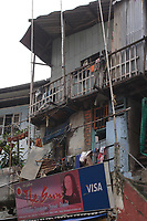 , Vietnam - 2007 File Photo -<br /> <br /> <br /> A VISA adverditing banner on the side of a house in a poor are of Vietnam<br /> <br /> <br /> photo : James Wong-  Images Distribution