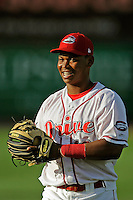 Third baseman Rafael Devers (13) of the Greenville Drive warms up before a game against the Lexington Legends on Tuesday, May 19, 2015, at Fluor Field at the West End in Greenville, South Carolina. Devers is the No. 6 prospect of the Boston Red Sox, according to Baseball America. (Tom Priddy/Four Seam Images)