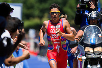 02 JUN 2013 - MADRID, ESP - Javier Gomez (ESP) (in red) of Spain attempts to catch Jonathan Brownlee (GBR) of Great Britain (not pictured) during the run at the men's ITU 2013 World Triathlon Series round in Casa de Campo, Madrid, Spain <br /> (PHOTO (C) 2013 NIGEL FARROW)