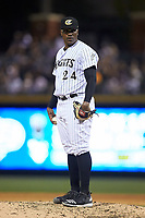 Charlotte Knights relief pitcher Thyago Vieira (24) looks to his catcher for the sign against the Scranton/Wilkes-Barre RailRiders at BB&T BallPark on April 12, 2018 in Charlotte, North Carolina.  The RailRiders defeated the Knights 11-1.  (Brian Westerholt/Four Seam Images)