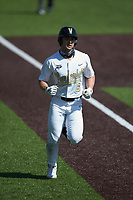 Tate Kolwyck (6) of the Vanderbilt Commodores jogs towards home plate after hitting a 2-run home run against the South Carolina Gamecocks at Hawkins Field on March 20, 2021 in Nashville, Tennessee. (Brian Westerholt/Four Seam Images)