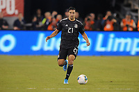 EAST RUTHERFORD, NJ - SEPTEMBER 7: Jorge Sanchez #21 of Mexico kicks the ball during a game between Mexico and USMNT at MetLife Stadium on September 6, 2019 in East Rutherford, New Jersey.