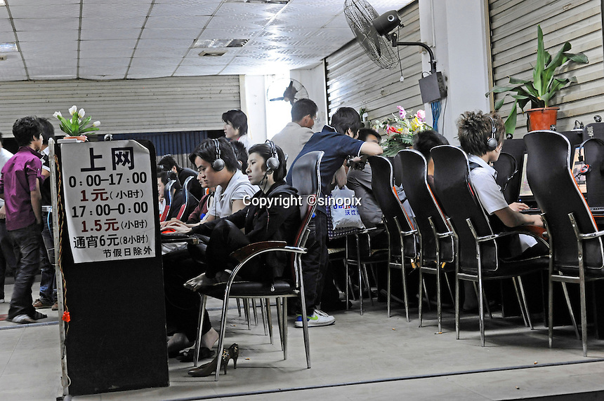 A packed internet cafe in Shenzhen, China. Internet cafe in China that admit three or more underage patrons will have their licences revoked under the government's latest effort to tighten controls on web access in the world's largest online market..21 Apr 2010