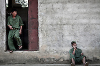 KIA recruits during a resting time from their basic training program at one of the trainig camps outskirsts Laiza city, the headquarters of the Kachin Independence rebel Army. The KIA is enhancing its troops number since the ceasefire was broken out by the Burmese army last June 2011. During months the fighting were spread out along the Kachin State leaving more than 40,000 displaced persons and refugees (a conservative estimating) in accord with the humanitarian aid groups.