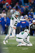 New York Jets Jason Myers (2) kicks an extra point as Lac Edwards (4) holds during an NFL football game against the Buffalo Bills, Sunday, December 9, 2018, in Orchard Park, N.Y.  (Mike Janes Photography)