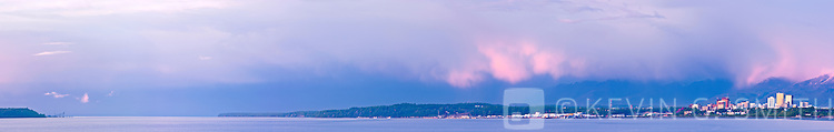 The Anchorage Skyline at sunset, Knik arm in the foreground, alpenlow on the mountains, Anchorage, Soiuthcentral Alaska, USA.