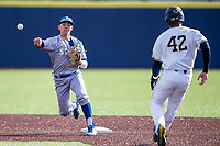 San Jose State Spartans shortstop Aaron Pleschner (11) turns a double play against the Michigan Wolverines on March 27, 2019 in Game 1 of the NCAA baseball doubleheader at Ray Fisher Stadium in Ann Arbor, Michigan. Michigan defeated San Jose State 1-0. (Andrew Woolley/Four Seam Images)