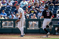 Michigan Wolverines first baseman Jimmy Kerr (15) celebrates winning Game 1 of the NCAA College World Series against the Texas Tech Red Raiders on June 15, 2019 at TD Ameritrade Park in Omaha, Nebraska. Michigan defeated Texas Tech 5-3. (Andrew Woolley/Four Seam Images)