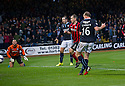 Dundee's David Clarkson scores their first goal.